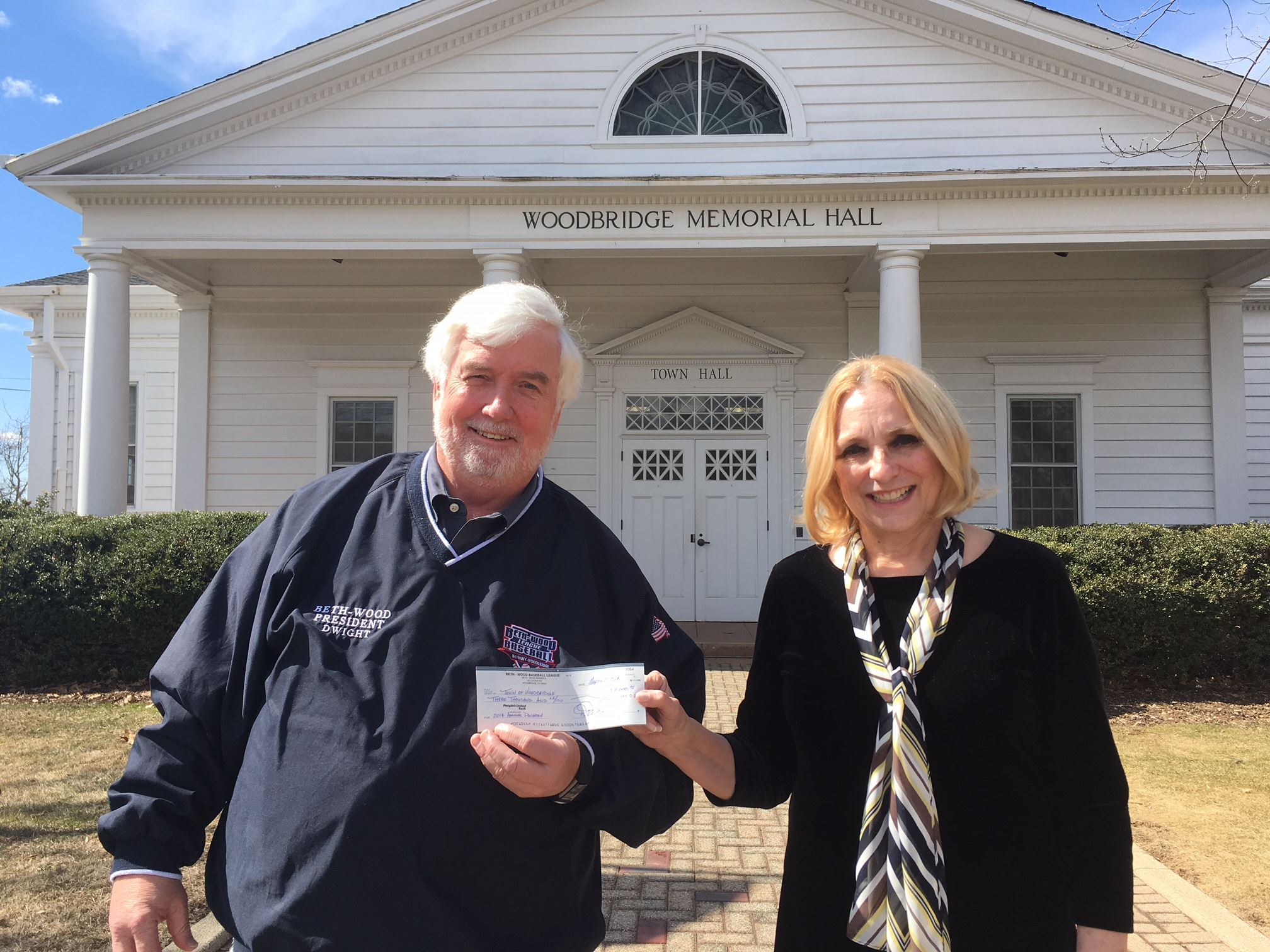 Dwight Rowland presents check to First Selectman Beth Heller